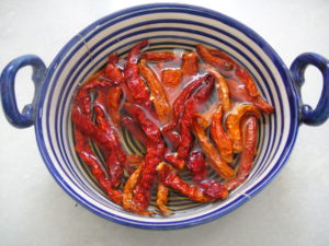 Soak red chillies in water.